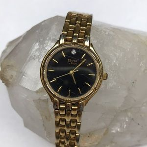 Caravelle Bulova gold watch Japan water resistant